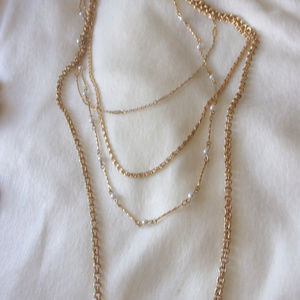 Jewelry - Four strand gold tone chain necklace killer clasp